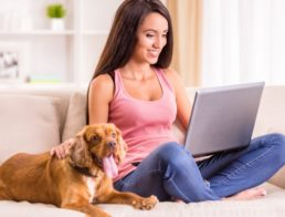 Woman with pet using laptop